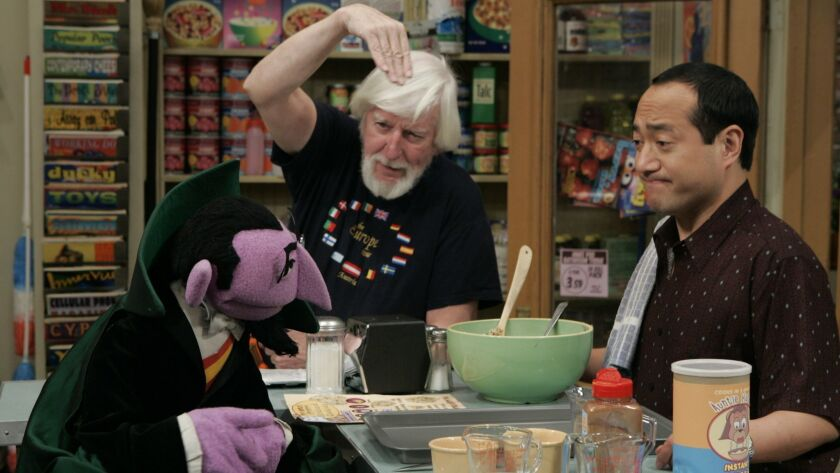 """In a 2004 photo provided by Richard Termine, Caroll Spinney, the original Big Bird and Oscar the Grouch, is shown rehearsing on the set of """"Sesame Street"""" with the Count and Alan Muraoka. The 84-year-old puppeteer announced that his five-decade run is ending in October 2018,"""