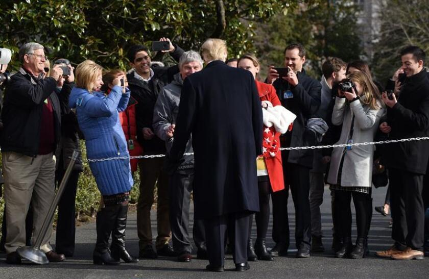US President Donald J. Trump greets guests while departing the White House in Washington, DC, USA, on Dec. 8, 2018. Trump said before departing for the 119th Army-Navy Football Game in Philadelphia that his chief of staff, John Kelly, will resign by the end of the year. EPA-EFE/Olivier Douliery/POOL
