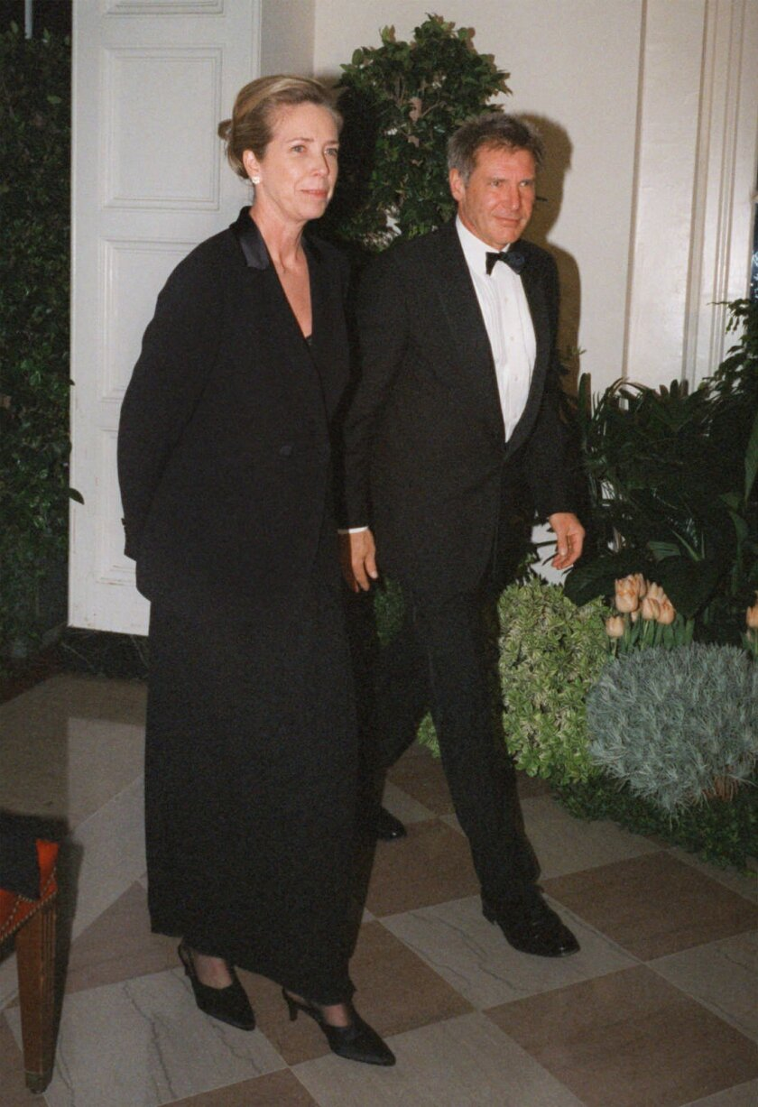 FILE - In this Feb. 5, 1998 file photo, Harrison Ford and his wife Melissa Mathison arrive at the White House for an official dinner for the British Prime Minister hosted by President Clinton in Washington. Mathison, the screenwriter who crafted the enchanting worlds of iconic family films includin
