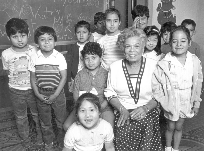 Ann Shaw, who breached racial barriers during five decades of civic activism in Los Angeles, has died at the age of 93. Here she poses with children from the Salvation Army Day Care Center.