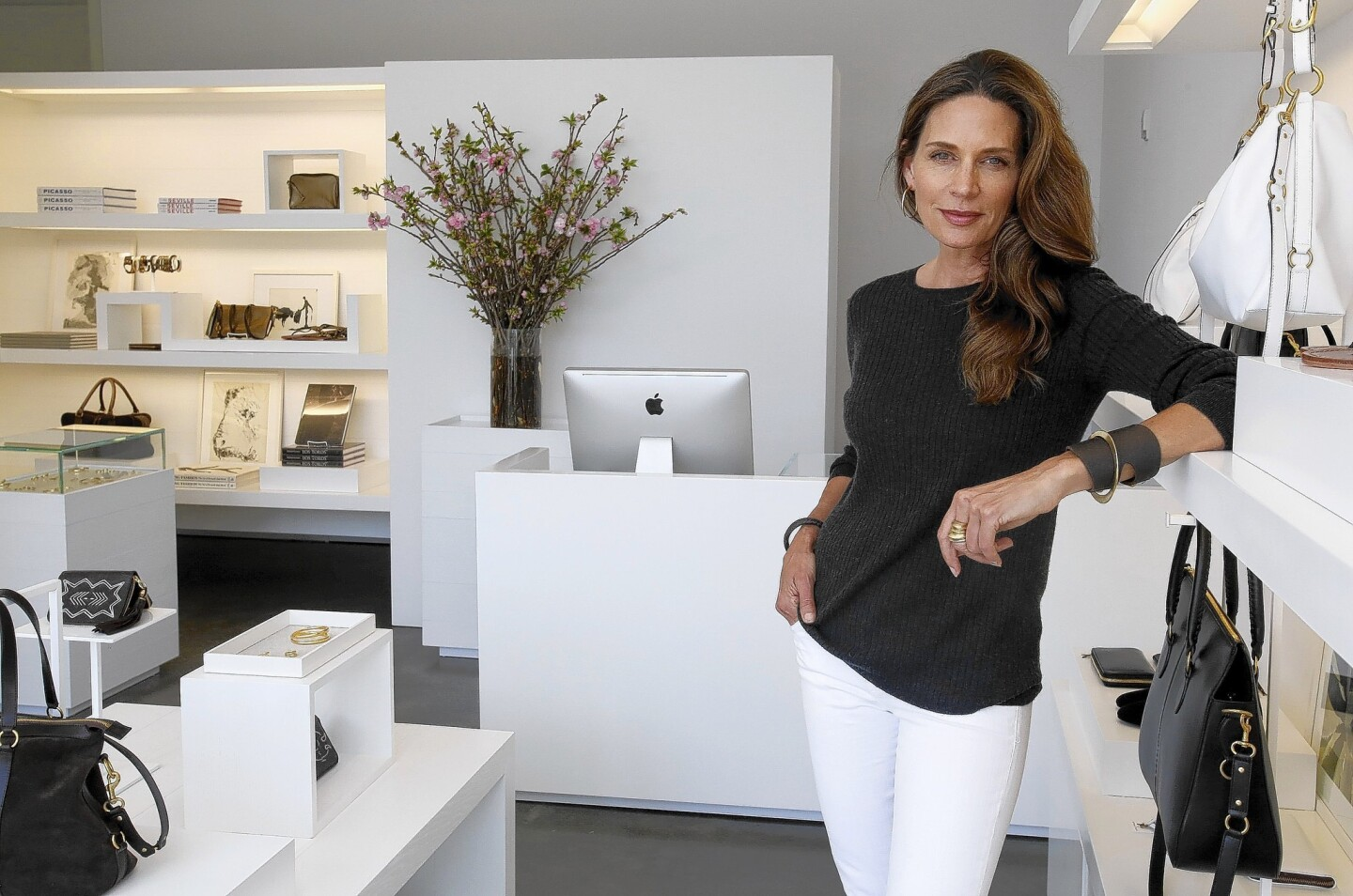 Fashion designer Kendall Conrad, who made her mark in handbags, is expanding into footwear and brass jewelry.