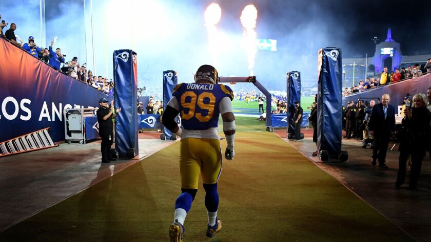 Rams Aaron Donald is introduced before a game against the Eagles at the Coliseum on Dec. 17, 2018.