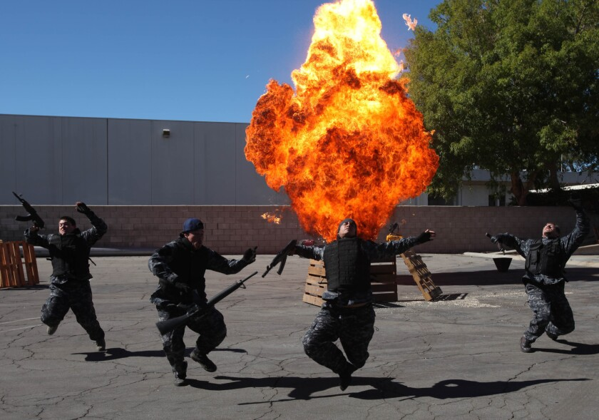 The State Fire Marshal held a three-day class to educate fire inspectors about the use of explosives on film sets. Stunt people react to an explosion during one of the scenarios.