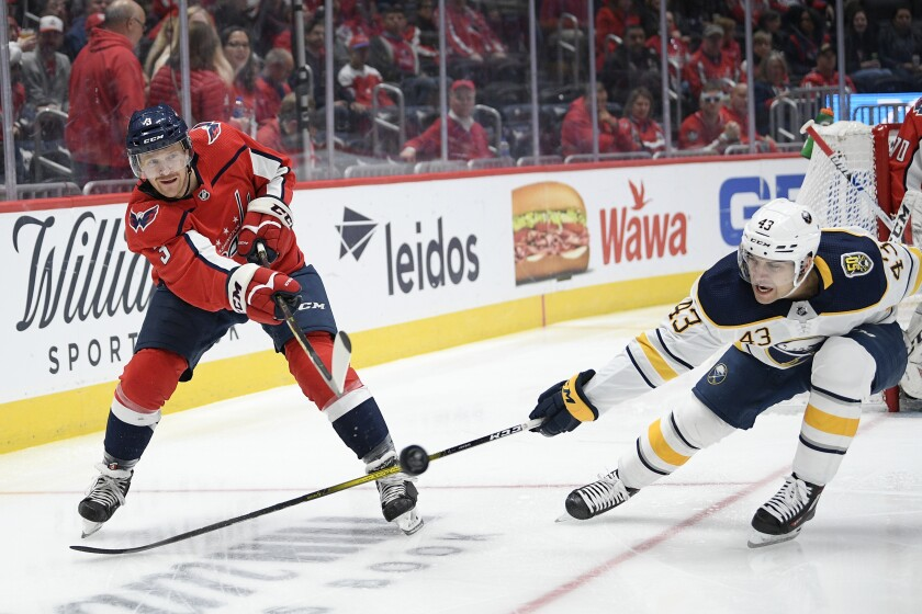 Washington Capitals defenseman Nick Jensen (3) passes the puck as Buffalo Sabres left wing Conor Sheary (43) defends during the second period of an NHL hockey game Friday, Nov. 1, 2019, in Washington. (AP Photo/Nick Wass)