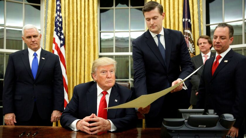 FILE PHOTO: Porter hands document to Trump during signing ceremony in the Oval Office in Washington
