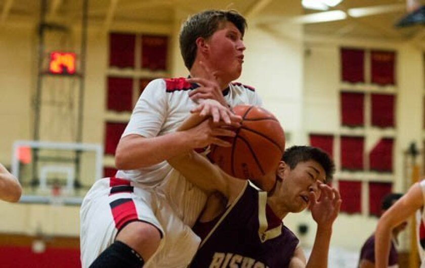Elijah Kerns (left) of La Jolla High School and Eric Yu of The Bishop's School tussle for the ball. Ed Piper