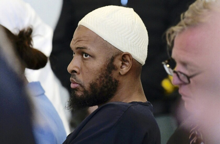 Siraj Ibn Wahhaj sits in court in Taos, N.M., during a detention hearing on Aug. 13,