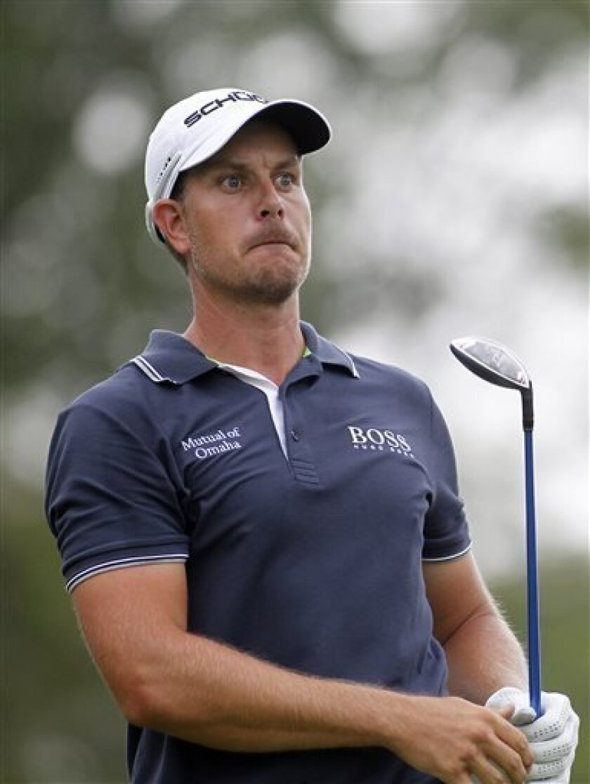 Henrik Stenson, from Sweden, watches his tee shot on the 17th hole during the second round of the Deutsche Bank Championship golf tournament in Norton, Mass., Saturday, Aug. 31, 2013. (AP Photo/Stew Milne)