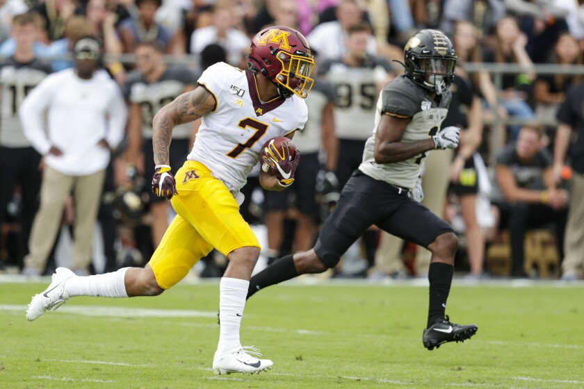 Minnesota wide receiver Chris Autman-Bell (7) heads to the end zone past Purdue cornerback Dedrick Mackey (1) after a catch during the first half of an NCAA college football game in West Lafayette, Ind., Saturday, Sept. 28, 2019. (AP Photo/Michael Conroy)