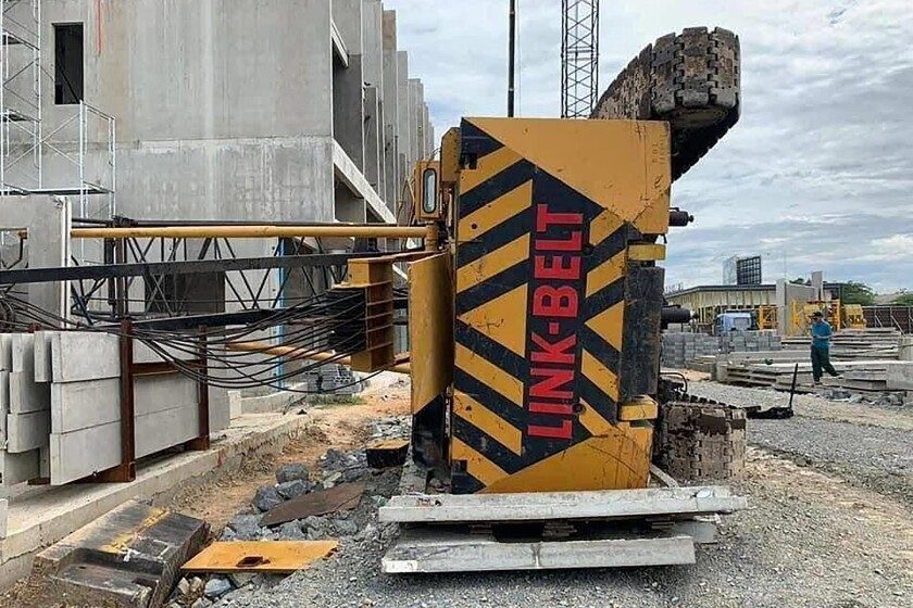 In this photo provided by the Poipet Authority Police, a crane lies near a Cambodia-Thai international border gate in Poipet, west of Phnom Penh, Cambodia, Wednesday, Aug. 12, 2020. The construction crane collapsed Wednesday, was being operated on ground made wet by rain, rendering it unstable, according to a police. (Poipet Authority Police via AP)