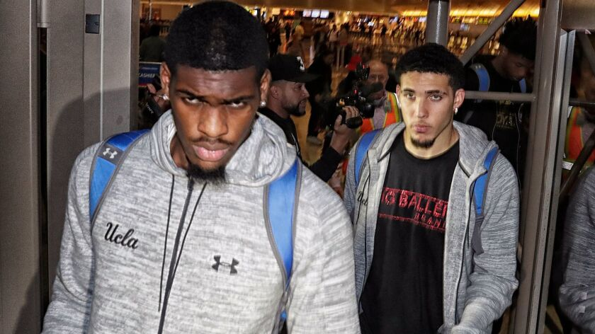 UCLA basketball players caught shoplifting while on a team trip to China, Cody Riley, left, Jalen Hill, not pictured, and LiAngelo Ball return from Shanghai, China at LAX on Nov. 14, 2017.