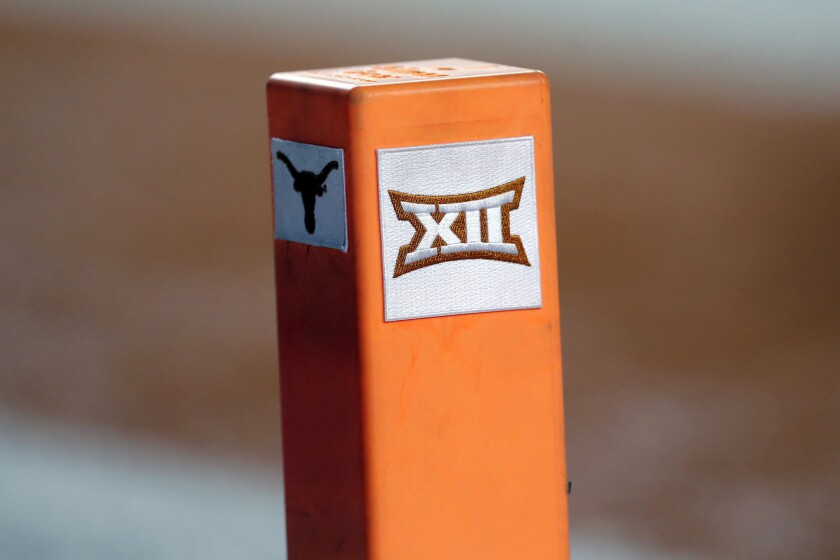"""FILE - In this Sept. 15, 2018, file photo, the Big 12 conference logo is seen on a pylon during the first half of an NCAA college football game between Texas and USC in Austin, Texas. Texas and Oklahoma made a request Tuesday, July 27, 2021, to join the Southeastern Conference — in 2025 —- with SEC Commissioner Greg Sankey saying the league would consider it in the """"near future."""" (AP Photo/Eric Gay, File)"""
