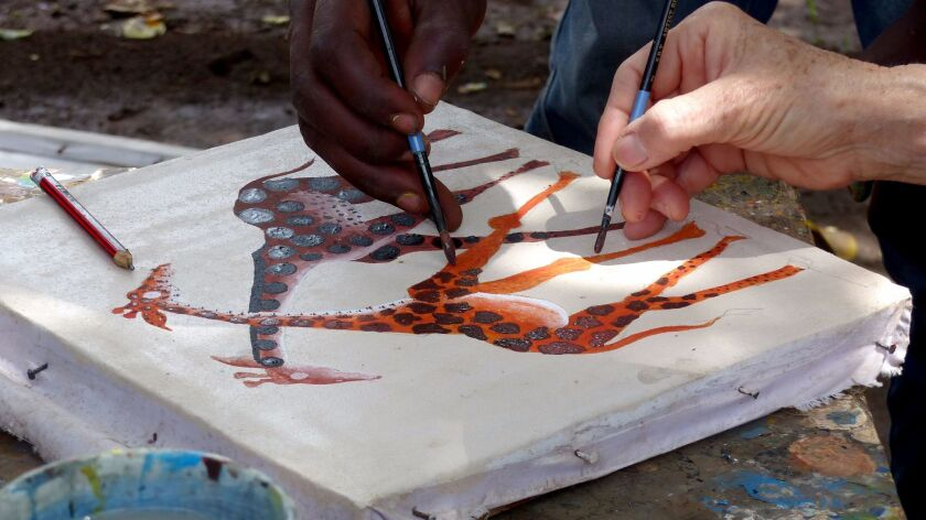 Getting a lesson in Tinga Tinga painting at the Ujamaa artists cooperative in Mto wa Mbu.
