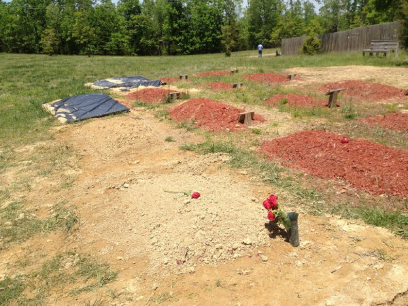 Flowers are placed on the reported burial site of Boston Marathon bombing suspect Tamerlan Tsarnaev in Doswell, Va., on Friday.