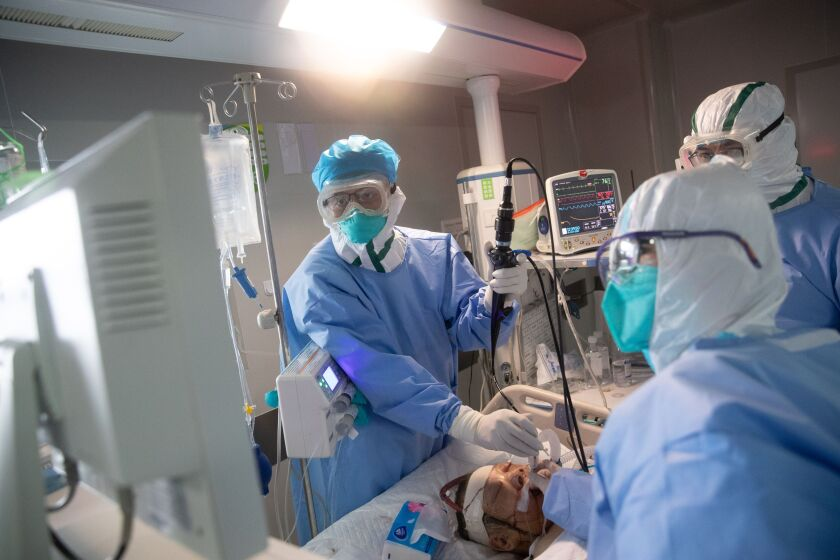 A patient with COVID-19 is treated at a hospital in Wuhan, China.