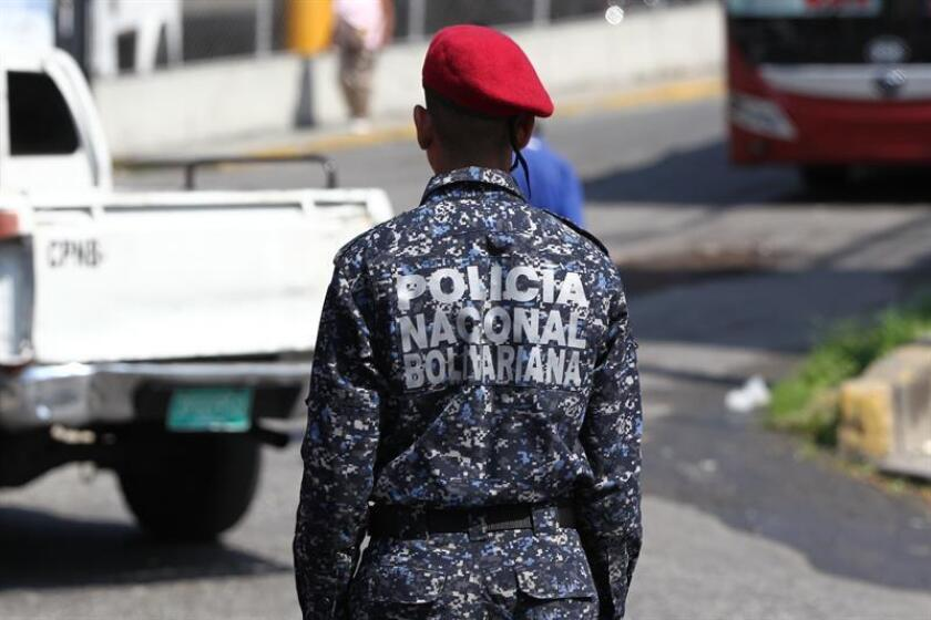 A member of Venezuela's National Police force is seen on March 21, 2019, in the vicinity of the Helicoide government building, where Roberto Marrero - the chief of staff of self-proclaimed interim president, Juan Guaido - is being held in Caracas, Venezuela. Guaido, who has been recognized as interim president of Venezuela by more than 50 countries, denounced the March 21 arrest at Marrero's home in Caracas and demanded his top aide's immediate release. EPA-EFE/Raul Martinez