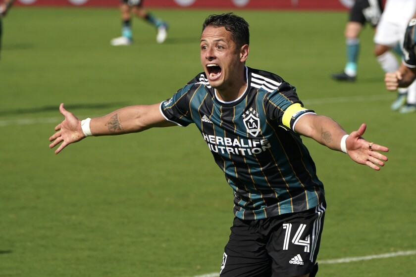 """Javier """"Chicharito"""" Hernández celebrates after scoring a goal during the second half of the Galaxy's 3-2 win."""