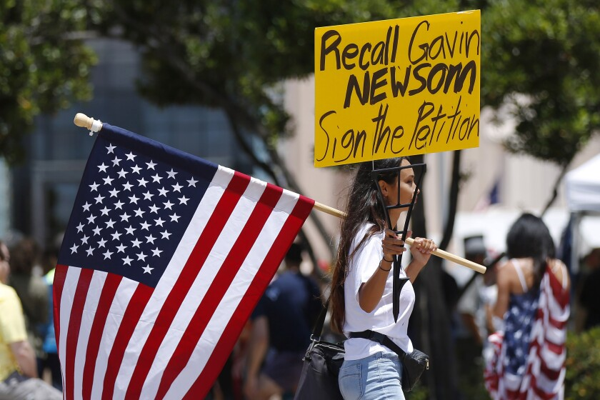 People attend a rally calling for Gov. Gavin Newsom to be recalled in San Diego in June 2020.