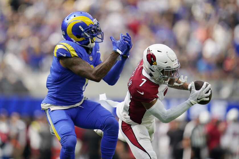 Arizona Cardinals cornerback Byron Murphy right, intercepts a pass intended for Los Angeles Rams wide receiver DeSean Jackson during the first half in an NFL football game Sunday, Oct. 3, 2021, in Inglewood, Calif. (AP Photo/Ashley Landis)