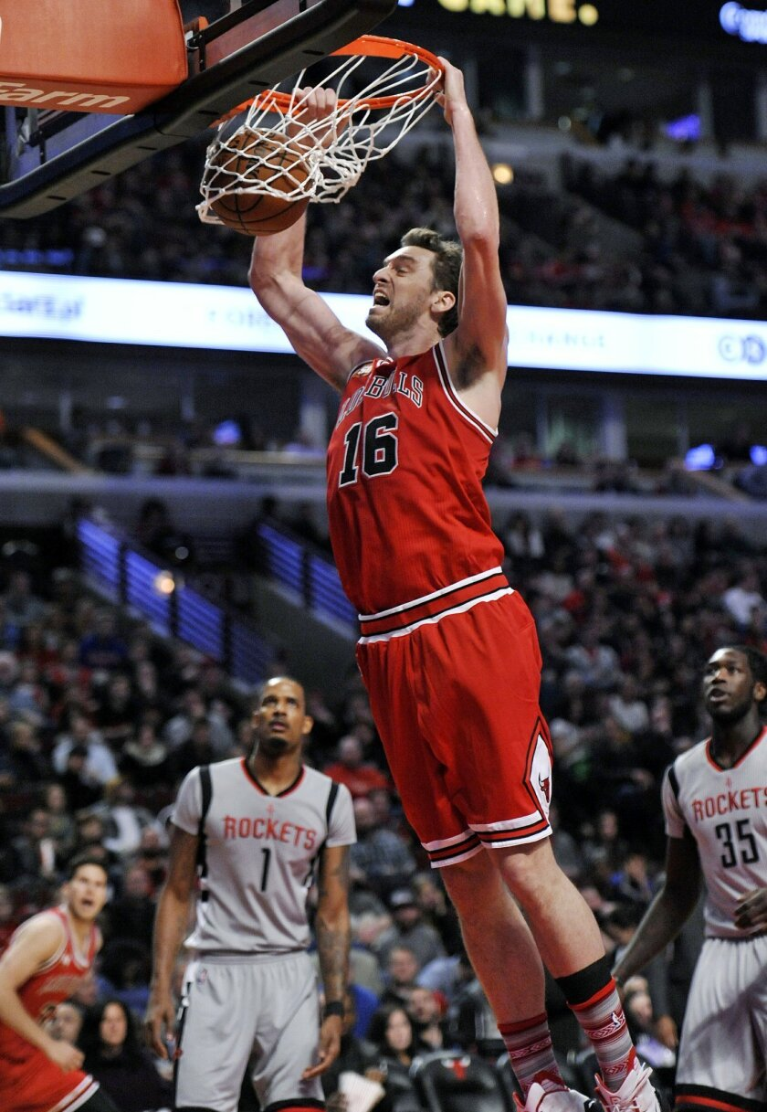 FILE - This is a Saturday, March 5, 2016 file photo of Chicago Bulls' Pau Gasol (16), of Spain, as he dunks during the second half of an NBA basketball game against the Houston Rockets on in Chicago. Chicago won 108-100.  Pau Gasol says he is considering not playing at the Olympics because of the Z