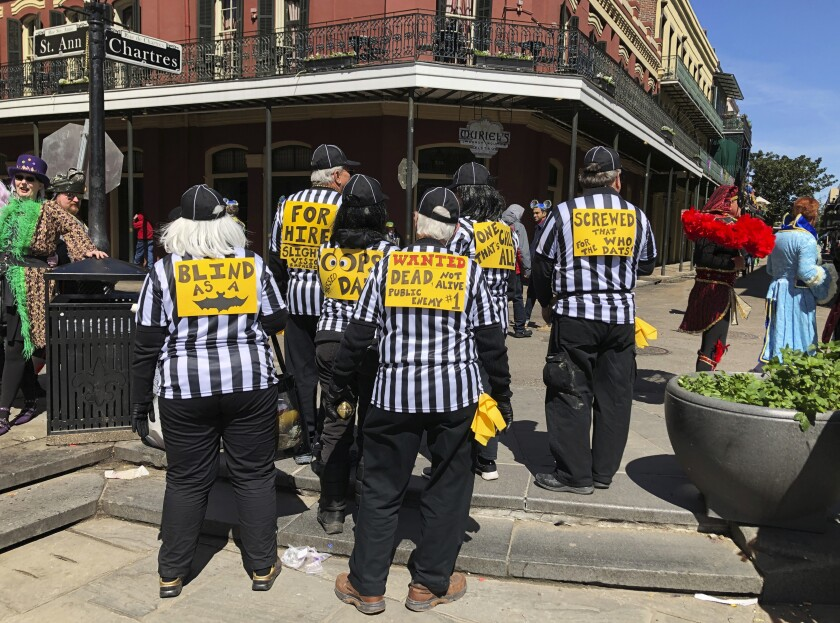 A group of people dressed as blind referees attend Fat Tuesday celebrations in New Orleans in March.