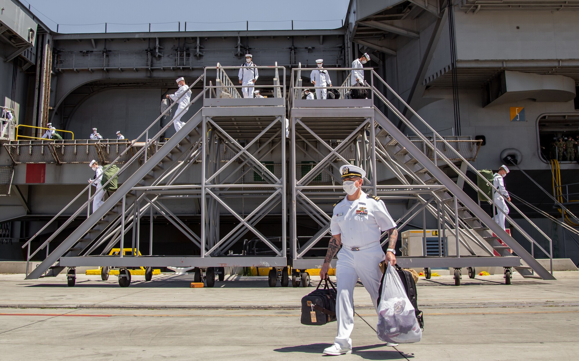 Sailors disembark from USS Theodore Roosevelt after almost six months at sea.