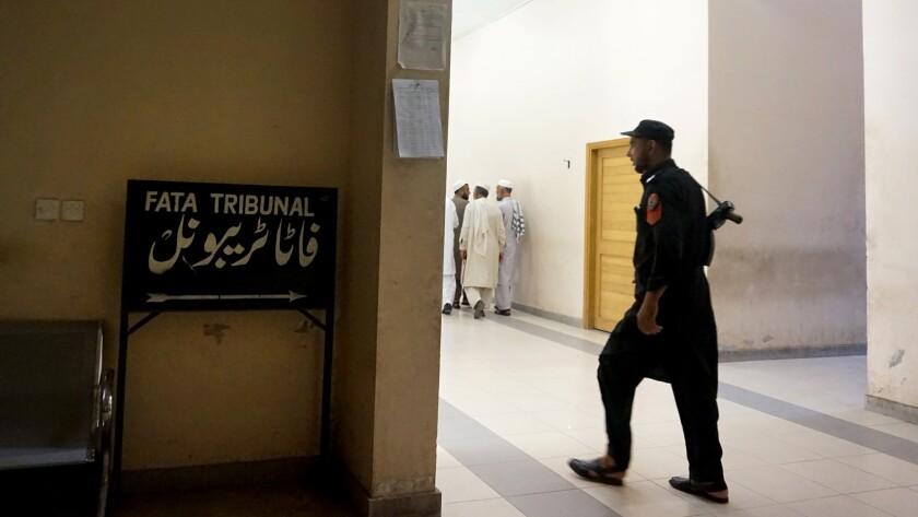 A tribal security officer at the FATA Tribunal.