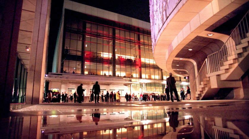 "Theatergoers brave the rain to attend the reopening of the Ahmanson Theatre for the premiere of ""Mis"