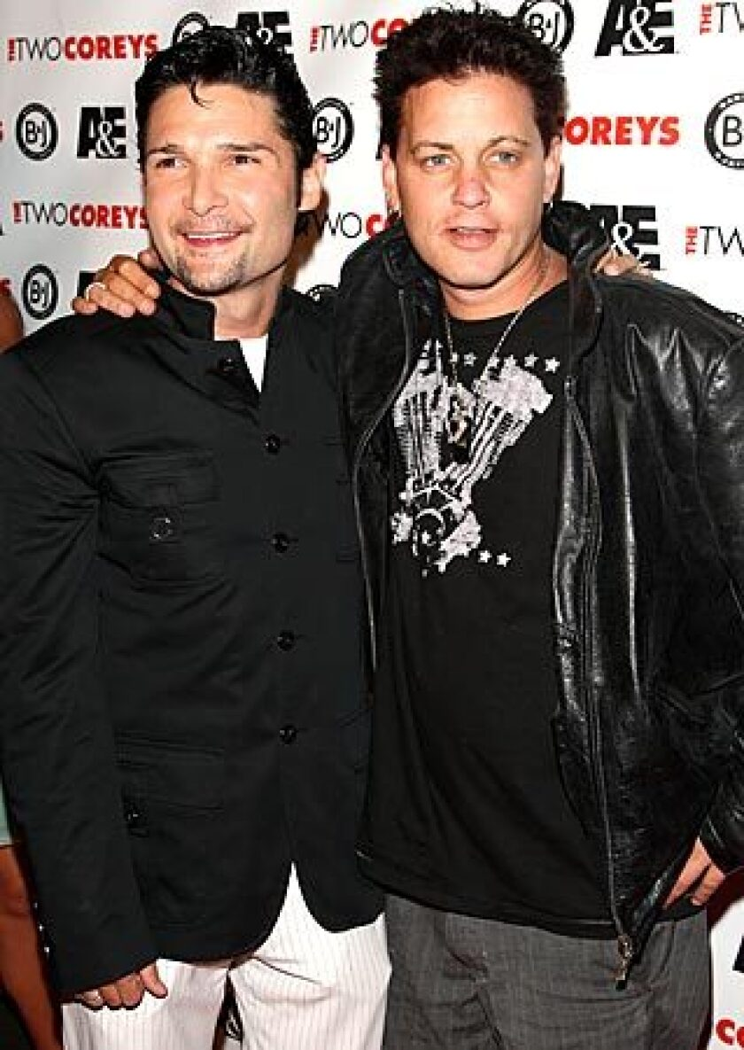 "Corey Feldman, left, and Corey Haim attend the premiere of ""The Two Coreys,"" an A&E reality show, in 2007."