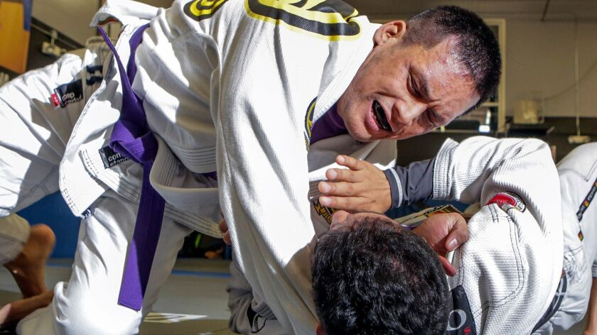 Jeff Mata, top, grapples with sparring partner Christian Lopez at the San Diego Brazilian Jiu-Jitsu Academy in San Marcos on Friday.