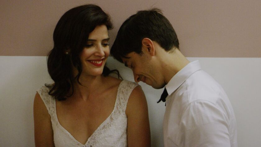 "Cobie Smulders and Justin Long in the film ""Literally, Right Before Aaron."""