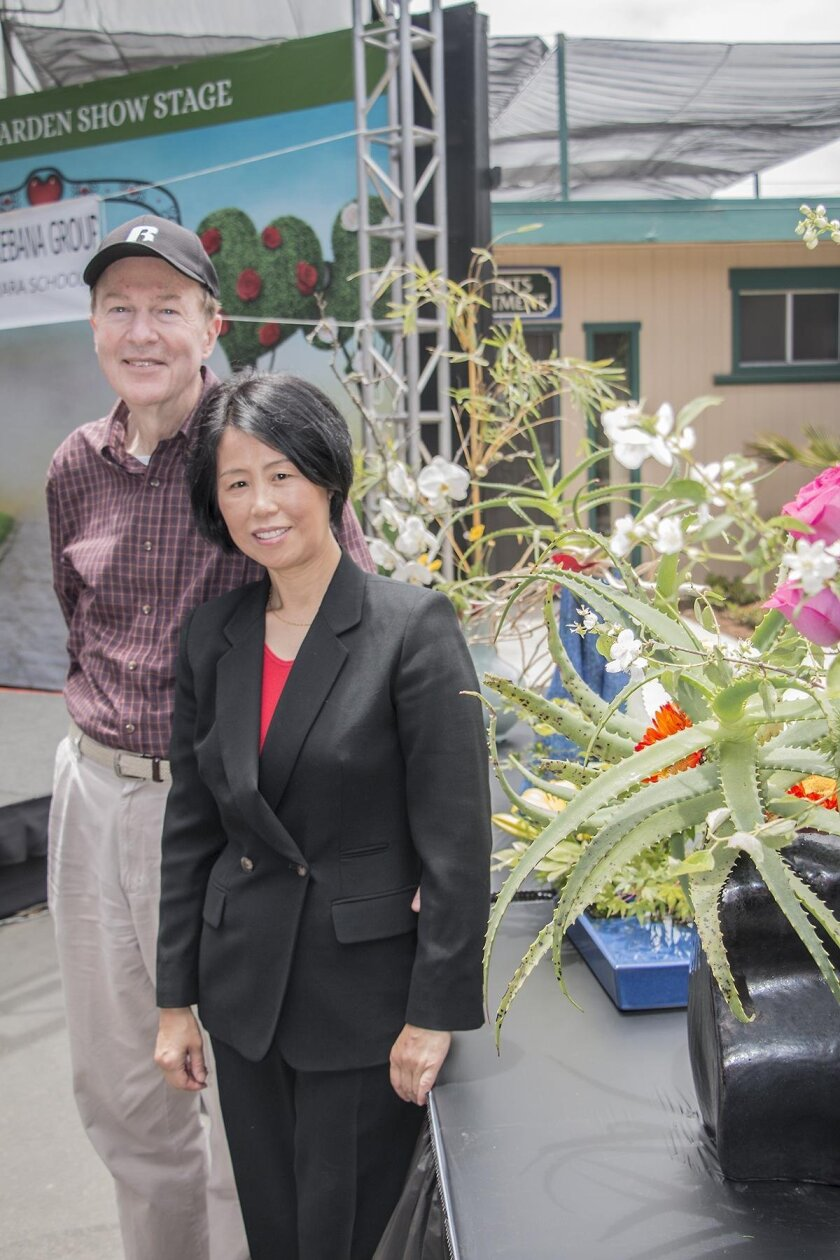 Jackie with Ronald Betts, her 'Ikebana husband,' who helps carry water, cut branches and transport heavy containers. 'He's 100 percent supportive,' she said.