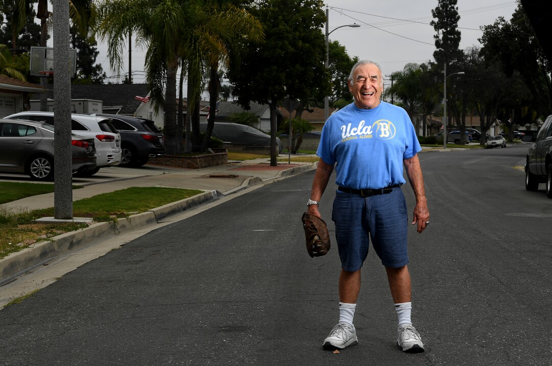 Ernie Rodriguez in his Whittier neighborhood with the first baseball glove he owned.
