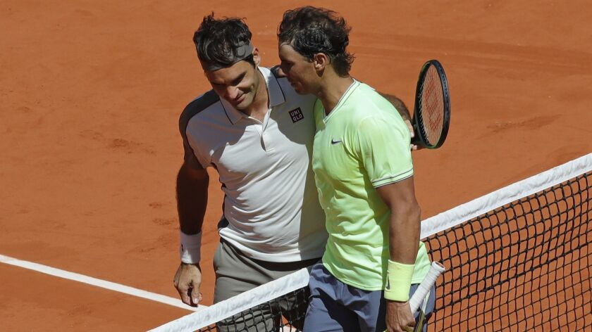 Spain's Rafael Nadal, right, is congratulated by Switzerland's Roger Federer after winning their sem