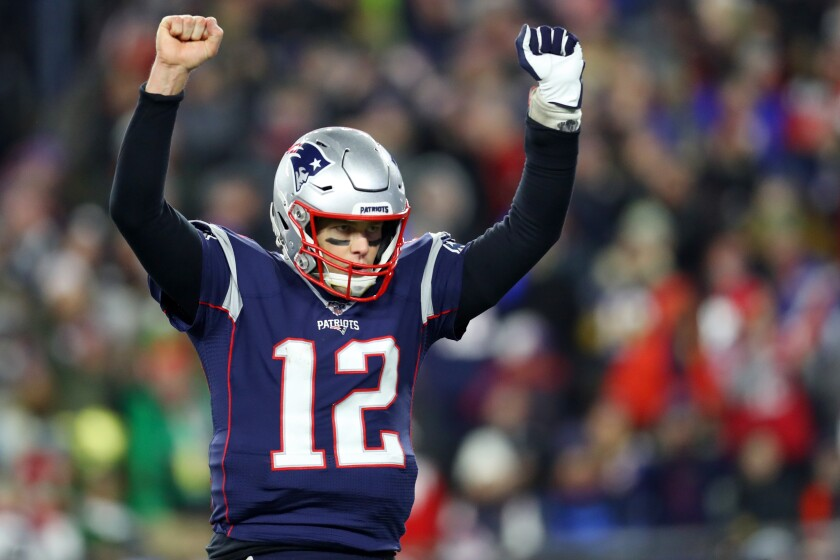 New England quarterback Tom Brady celebrates Rex Burkhead's go-ahead, one-yard touchdown run Dec. 21, 2019.