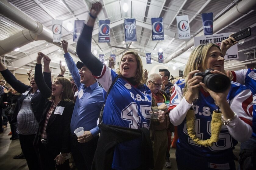 Supporters of Texas Sen. Ted Cruz celebrate his victory Monday night in Iowa's Republican presidential caucuses.