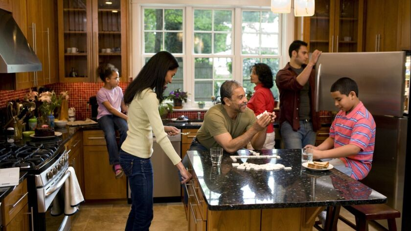 Multigenerational family in kitchen, by David Sacks, Getty Images ** OUTS - ELSENT, FPG, TCN - OUTS
