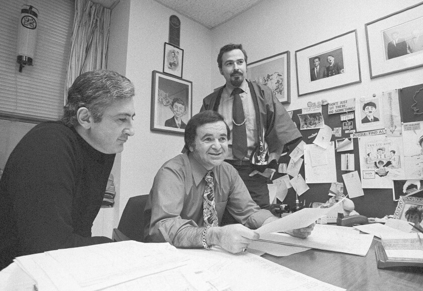 A May 1972 photograph of Mad magazine Editor Al Feldstein, center, in his office. As editor, he boosted circulation from around 375,000 to more than 2 million.