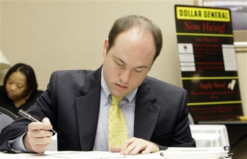 Steve Pruitt, from Belle Chasse, La., fills out an employment application during a Dollar General job fair in Metairie, La., Thursday, Jan. 8, 2009. The nation's unemployment rate bolted to 7.2 percent in December, the highest since early 1993, as nervous employers slashed 524,000 jobs. (AP Photo/A