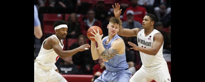"""USD's Alex Floresca (middle), the lone senior on the team, will try to help """"prove people wrong"""" after the Toreros were picked to finish ninth in the WCC."""