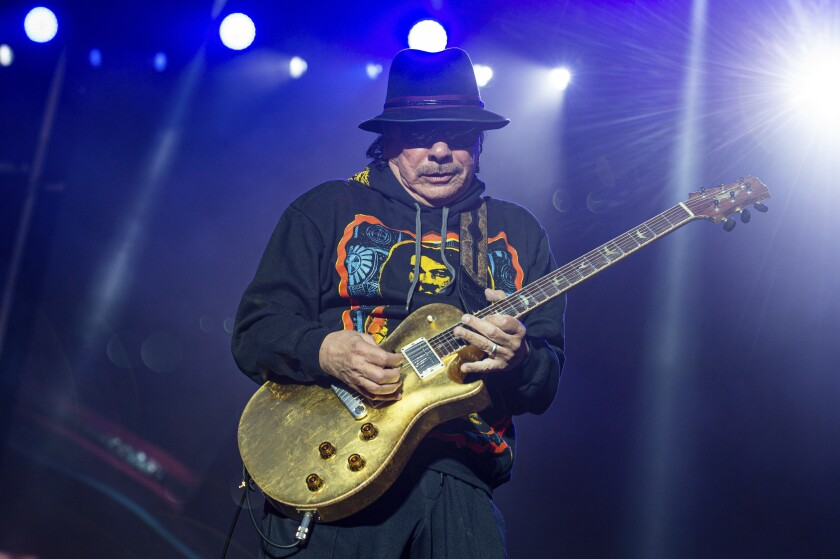 FILE - This May 26, 2019 file photo shows Carlos Santana of Santana performing at the BottleRock Napa Valley Music Festival in Napa, Calif. Santana announced Tuesday, March 10, 2020 that he has canceled the European tour dates of his Miraculous 2020 World Tour. Refunds will be available through point of purchase. He is the latest musician to cancel concerts because of public health concerns and performance restrictions due to the growing coronavirus outbreak. The vast majority of people recover from the new virus. According to the World Health Organization, people with mild illness recover in about two weeks, while those with more severe illness may take three to six weeks to recover. (Photo by Amy Harris/Invision/AP, File)