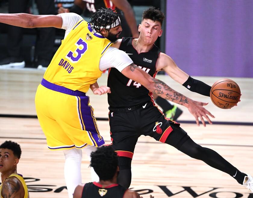 ORLANDO, FLORIDA SEPTEMBER 30, 2020-Lakers Anthoiny Davis forces Heat's Tyler Herro.