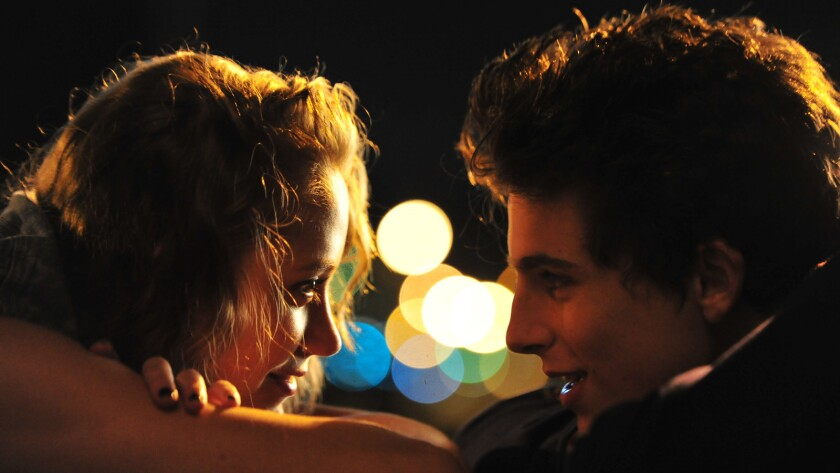 """Maika Monroe and Timothée Chalamet in the movie """"Hot Summer Nights."""""""