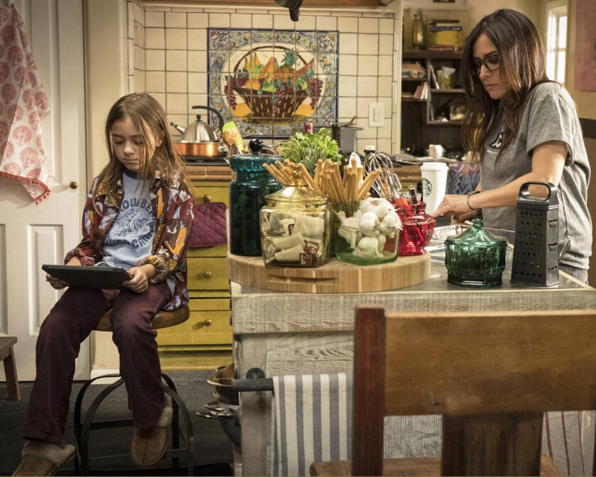 "Olivia Edward as Duke Fox, left, and Pamela Adlon as Sam Fox, in the family kitchen in ""Better Things."""