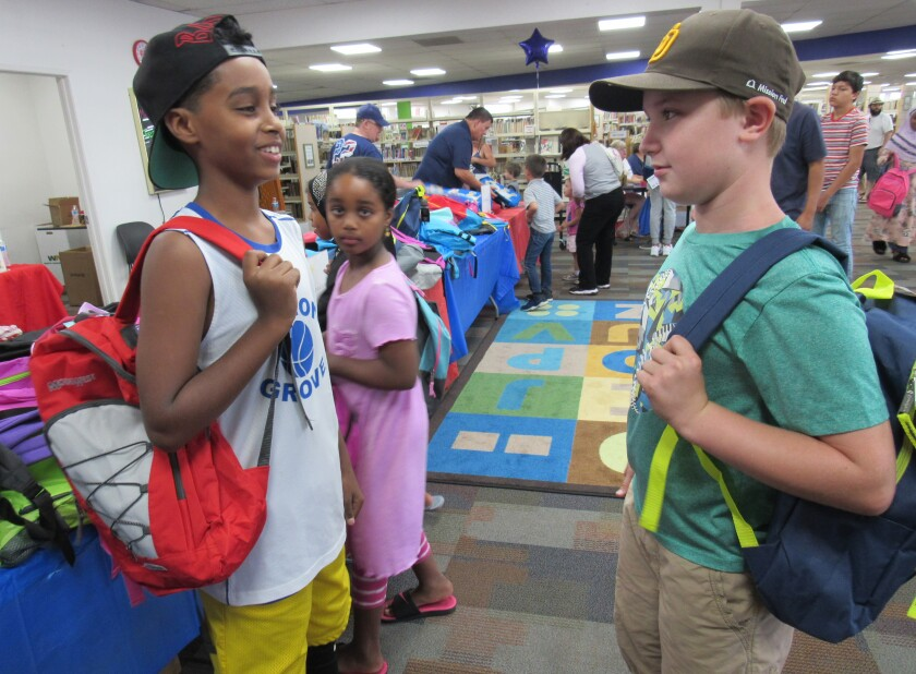 Local kids got new donated backpacks that were filled with back-to-school items last summer at the Santee Library.