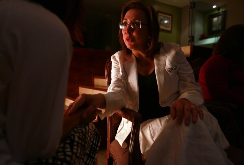 "Mexican Congresswoman Rosi Orozco comforts one of the women rescued from the human trafficking circuit, on an evening when several of the women were over at Orozco's home. Orozco's term in congress is expiring, but she is continuing the mission, as ""pres"