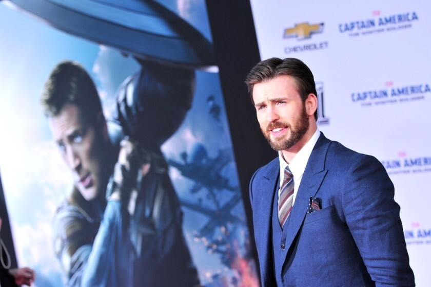 """Chris Evans, at the premiere in Los Angeles of """"Captain America: The Winter Soldier,"""" is getting into directing."""
