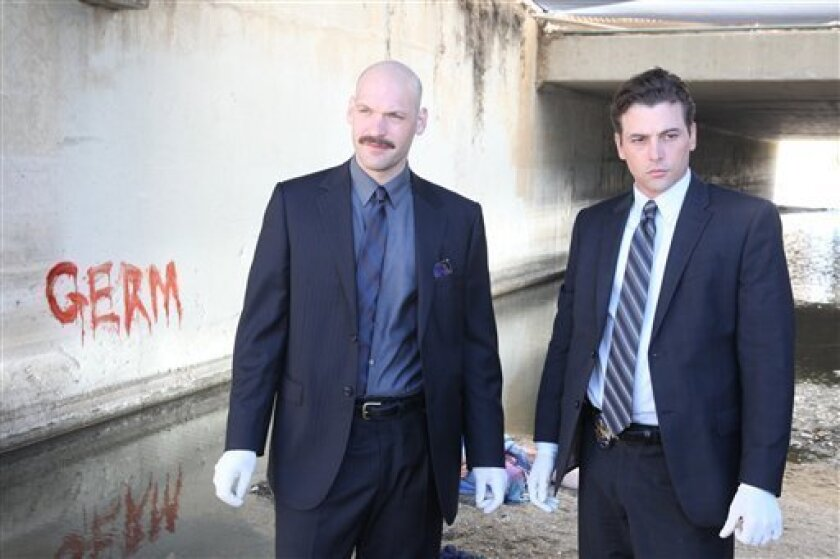 """In this undated publicity photo released by NBC, Corey Stoll, left, and Skeet Ulrich are shown in a scene from """"Law & Order: Los Angeles."""" (AP Photo/NBC)"""