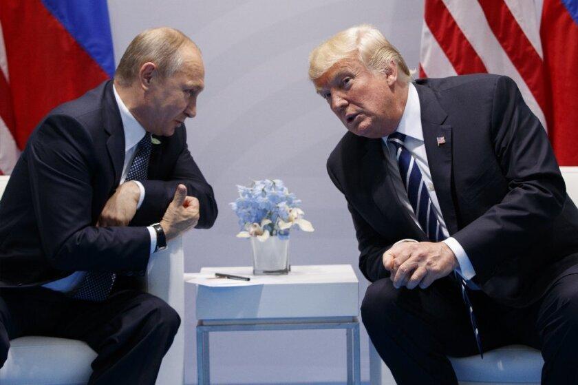 Donald Trump speaks with Russian President Vladimir Putin at the G20 Summit, July 7, 2017.