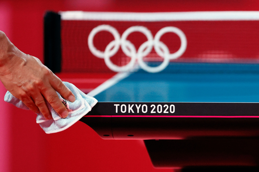 A worker disinfects a table tennis court at the Tokyo Metropolitan Gymnasium.